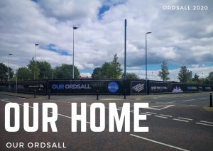 Photograph of a junction at a road in Ordsall, Salford. On a corner of two roads is a building site. The hoardings read 'Our Ordsall in blue lettering. The sky is blue, but cloudy. Over the photograph the words Our Home is typed in large capital letters, below it the words 'Our Ordsall'.