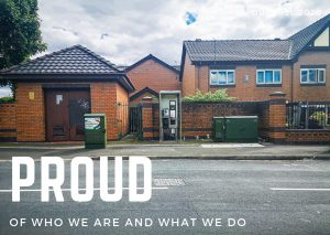 Photograph of a telephone box on a residential street in Ordsall, Salford. The sky is cloudy. Over the photograph the word Proud is typed in large capital letters, below it the words 'Of who we are and what we do'.